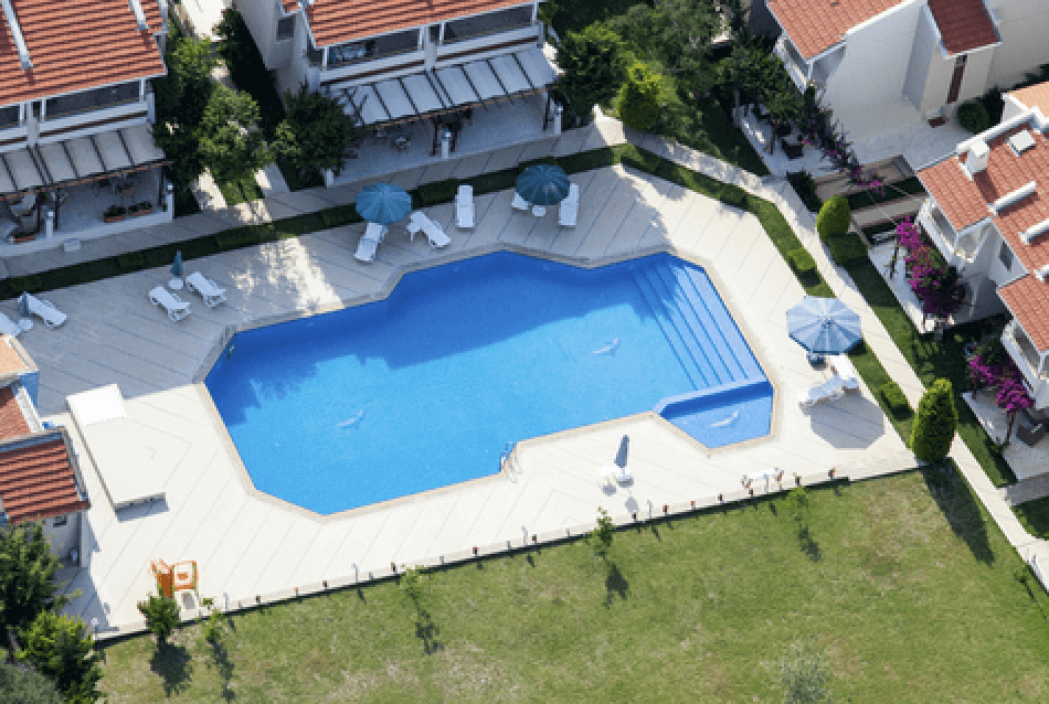 drone view of a house with a swiming pool